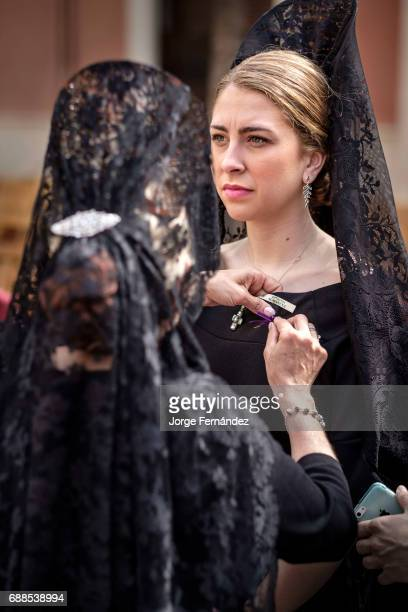 In Seville during what is known as 'Jueves Santo' or Holy Thursday is very typical for women to dress in black with the traditional attire