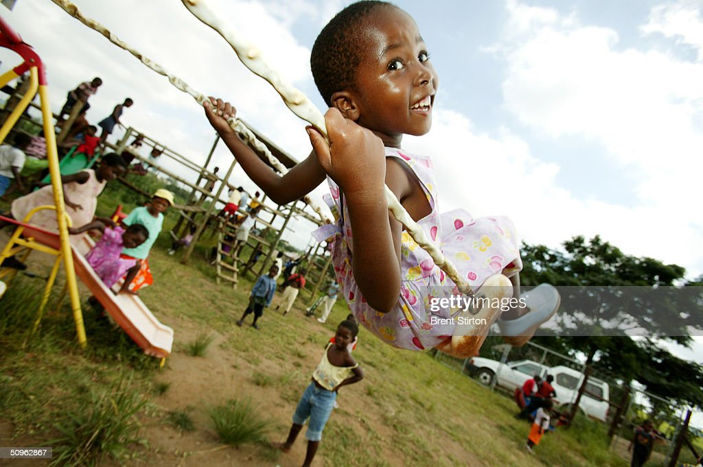 A girl plays on a swing at a day school facility for children March 29, 2004 in Richards Bay, South Africa. The day school is run by BHP Billiton and is for children who have lost their parents to AIDS or have been affected in some way by HIV. Some of the children are HIV positive. Getty Images is partnering with the Global Business Coalition on HIV/AIDS ongoing projects.