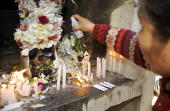 STORY in Spanish by Ruben Sandi A woman sprays alcohol on a 'atita' at the General Cemetery of La Paz on November 8 2008 Every November 8 according...