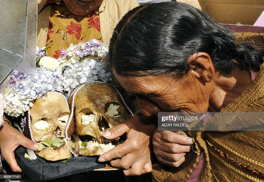 STORY in Spanish by Ruben Sandi An elderly native prays to two 'ñatitas' (human skulls) at the General Cemetery of La Paz on November 8, 2008. Every November 8 according to a pre-Columbian Andean tradition, thousands Bolivians celebrate the 'Day of the Ñatitas', or 'time of the death', venerating decorated skulls of relatives or unknown people, and making offerings to honour their ancestors.