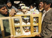 STORY in Spanish by Ruben Sandi Members of the Mamani family arrive with their seven 'ñatitas' at the chapel of the General Cemetery in La Paz to...