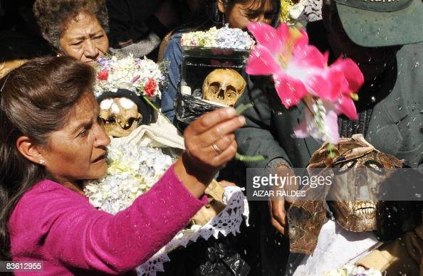 STORY in Spanish by Ruben Sandi People have their 'atitas' blessed at the General Cemetery in La Paz on November 8 2008 Every November 8 according to...