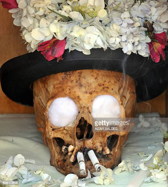 STORY in Spanish by Ruben Sandi Picture of a 'ñatita' of the Choque family that has been offered cigarrettes at the General Cemetery of La Paz on...