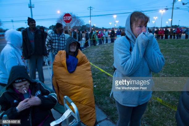 In subfreezing temperatures Dee Matello age 46 waits in line with hundreds of others for a shot at free dental care from the Eastern Shore Mission of...