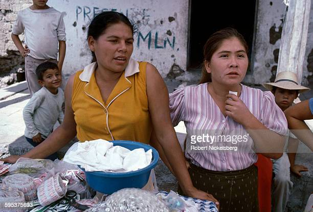 In territory held by Popular Revolutionary Forces guerrillas several villagers sell pharmaceutical drugs from an outdoor table Corinto El Salvador...