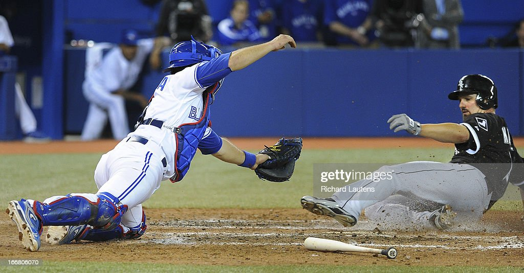In the 9th inning, Chicago White Sox first baseman Paul Konerko (14) slides into home for what turned out to be the winning run as Toronto Blue Jays catcher J.P. Arencibia (9) can't apply the tag. The Toronto Blue Jays Tuesday night lost to the Chicago White Sox 4-3 at the Rogers Centre. The night saw the season debut of Brett Lawrie at 3rd base.
