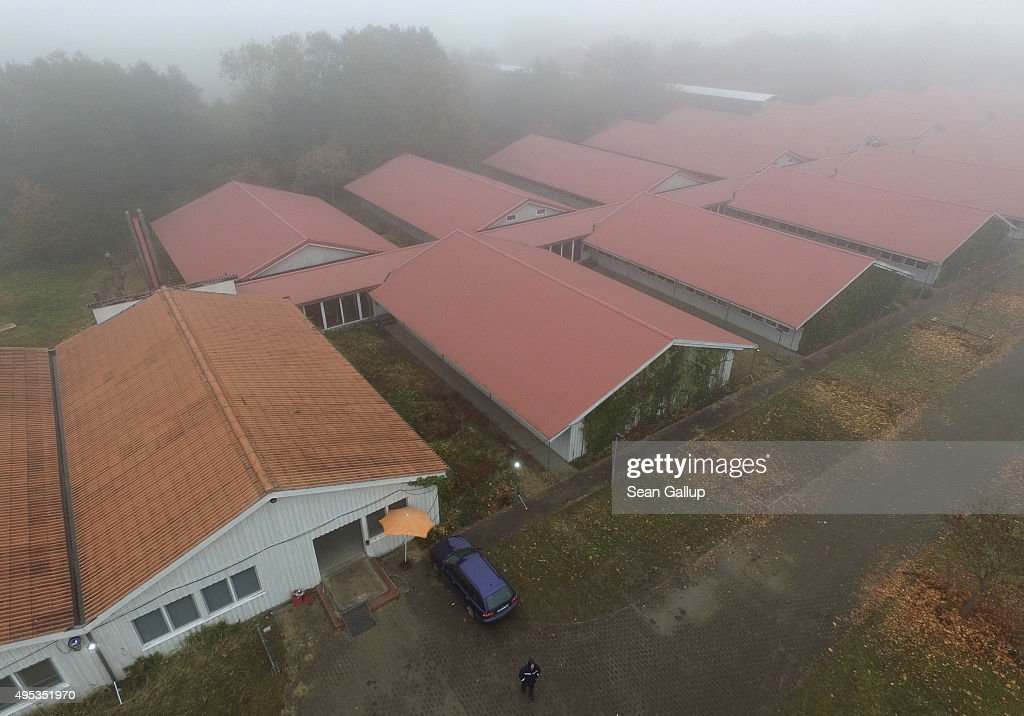 In the aerial view the buildings of a former office park that later today will become accommodation for migrants stand on November 2, 2015 in Sumte, Germany. Sumte, a farming village located southwest of Hamburg, has a population of 102, and starting later today it is to receive 500 migrants who will be housed in an abandoned office park on the village edge. The number of migrants at the shelter could reach up to 750 in coming weeks as Germany struggles to accommodate the unrelenting flood of migrants arriving at a rate of thousands per day. Authorities are distributing migrants seeking asylum in Germany at shelters nationwide, both in urban centers and in small, rural communities.