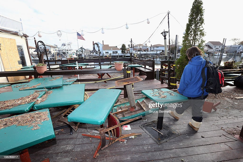 In the aftermath of Superstorm Sandy, bartender Lynn Wheat of Otto's Sea Grill on Woodcleft Avenue checks out the remnants of her resteraunt on November 2, 2012 in Freeport, New York. Otto's is the oldest establishment on the Nautical Mile. With the death toll continuing to rise and millions of homes and businesses without power, the U.S. east coast is attempting to recover from the effects of floods, fires and power outages brought on by Superstorm Sandy.