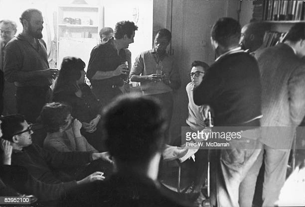 In the apartment of Robert Cordier guest gather to discuss 'The Funeral Of The Beat Generation' New York New York January 23 1961 Among the guests...