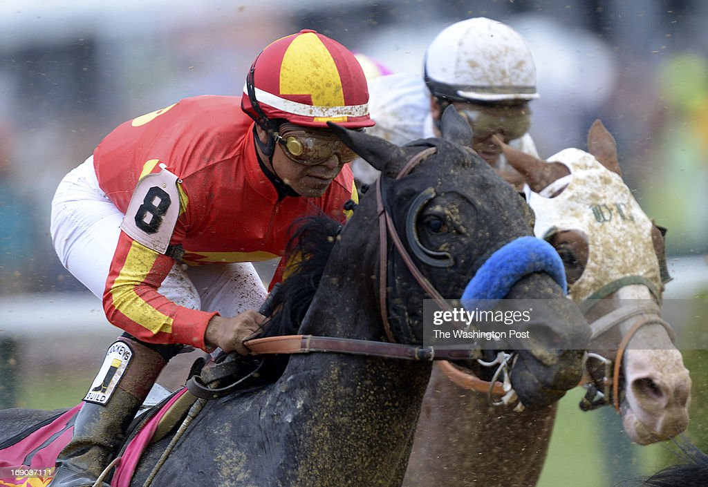 In the back of the pack, jockey Martin Garcia riding Governor Charlie gets dirty during the 138th Running of the Preakness Stakes at Pimlico Race Course in Baltimore, Md., on Saturday, May 18, 2013.