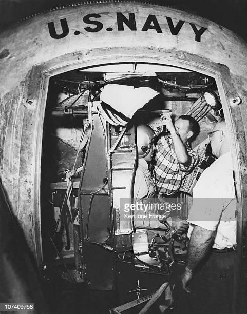 In The Center Of Development Of The Marine American Two Technicians Install Astronaut Walther Schirra In The Capsule Of The Centrifuge In The Setting...