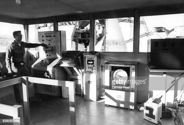 In the control tower which includes closed circuit Tv Bob Hughston manipulated flow of aggregates from the tunnel to storage bins or into asphalt...