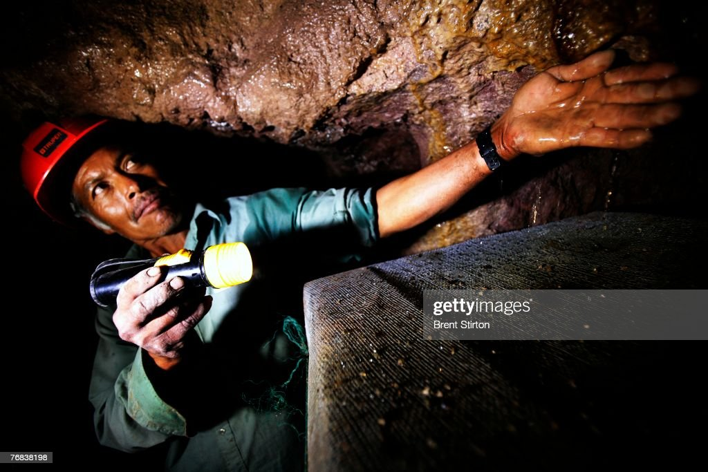 In the damp and narrow tunnels known as Gallerias Filtrantes Pedro Hernandez Martinez and Armando Castillo Osorio tend the work begun by their...