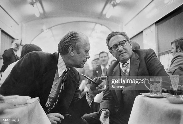 In the dining car on the train from Vladivostok to the airport on November 23 President Gerald Ford discusses progress on the SALT agreement with...