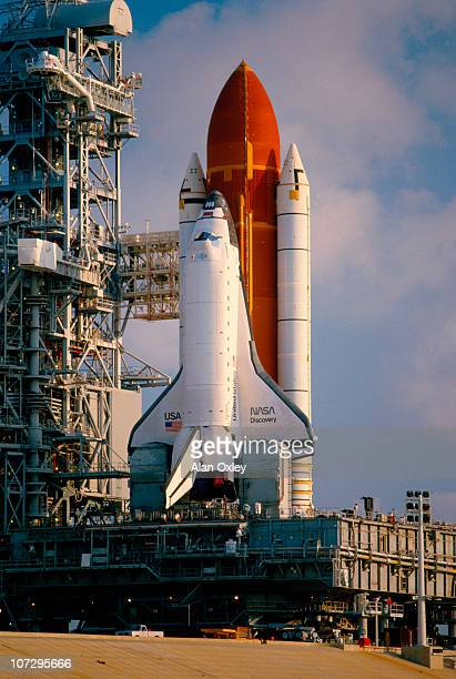 In the early morning sunlight of July 4 the Space Shuttle Discovery sits poised on a Cape Kennedy launch pad in Florida The launch scheduled for...