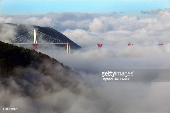 In The Early Morning The Highest Parts Of The Millau Viaduct Under Construction Raise on Top Of The Fog Here From Left To Right Piers P7 And P6 Which...