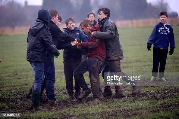 In the fading light children fight for the hessian Hood during the junior Haxey Hood game at Haxey Village on January 6 2017 in Doncaster England The...