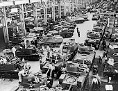 In the few short months since Pearl Harbor the Chrysler plant in Detroit is turning out tanks by the hundreds day and night Detroit Michigan June 18...