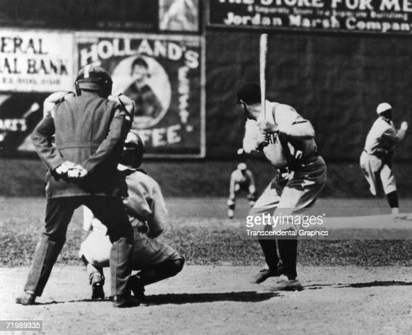 In the first photo of a sequence Babe Ruth New York Yankees outfielder readies to swing during a game against the Boston Red Sox at Fenway Park in...