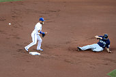 TORONTO ON JULY 22 In the first Toronto Blue Jays second baseman Devon Travis makes the out on Seattle Mariners right fielder Seth Smith but loses...