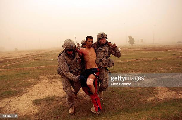 In the fog of an Iraqi sandstorm medic Sgt Matthew Kunkle and Private Aaron Livas US troops of the 2nd Battalion 30th Infantry Regiment of the 10th...