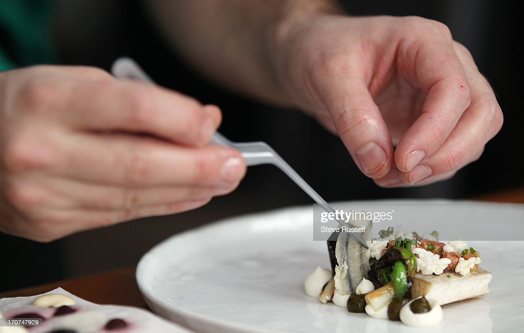In the food world some dishes are just as much for the eyes as they are for the palate. At Acadia restaurant on Clinton Street chef Patrick Kriss has the ability to make some dishes into works of art. He selects and places the food on plates with tweezers and uses paper towel as his palate in Toronto. December 29, 2012 STEVE