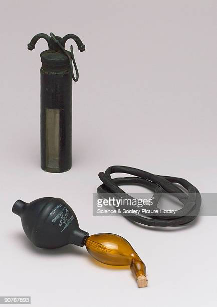 In the foreground is an inhaler for use with bronchovydrin penicillin made by Bronchovydrin Ltd of London In the background is a Junker�s chloroform...
