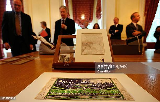 In the foreground the original artwork for the cover of the Hobbit by JRR Tolkein as Oxonians and press attend the Oxford University launch of a GBP...
