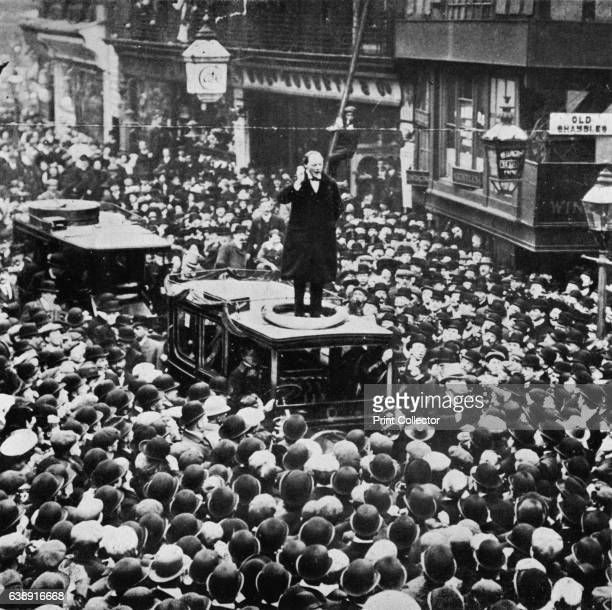 In the General Election he was defeated at Manchester but was returned for Dundee' Sir Winston Churchill standing on a tram as he speaks to the...