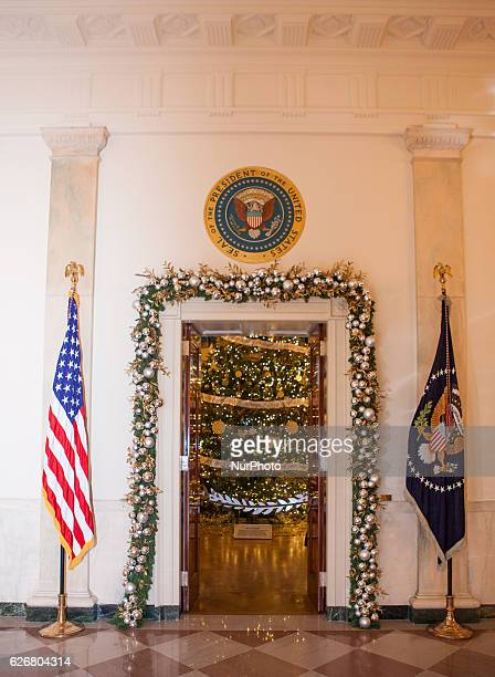 In the Grand Foyer of the White House holiday garland adorns the doorway looking in to The Blue Room where the White House Christmas Treea 19 foot...