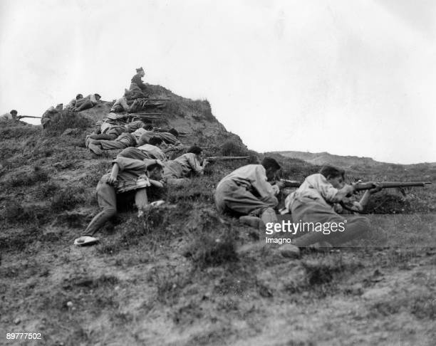 In the great battle for San Sebastian rebel soldiers take positon on the ridge of the Somosierra Mountainds overlooking San Sebastian Madrid Spain...
