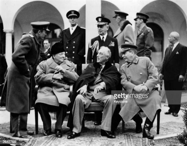 In the grounds of the Livadia Palace Yalta during the Three Power Conference the British wartime Prime Minister Sir Winston Leonard Spencer Churchill...