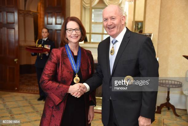 In the handout provided by Government House Sydney former Australian Prime Minister Julia Gillard shakes hands with GovernorGeneral of Australia Sir...