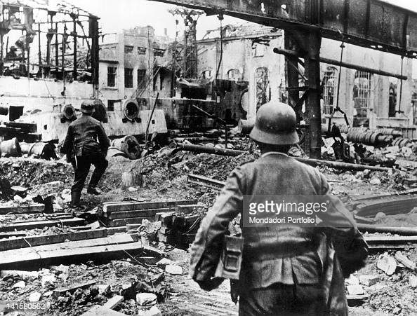 In the industrial district of Stalingrad today Volgograd a patrol of the Sixth Army advancing among the ruins Volgograd October 1942