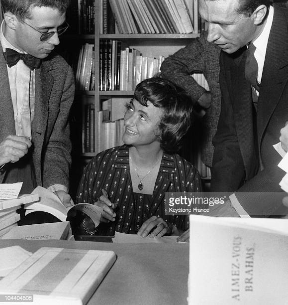 In the Julliard bookstore in Paris the young novelist Francoise SAGAN autographed a copy of her third work AIMEZVOUS BRAHMS to a reader
