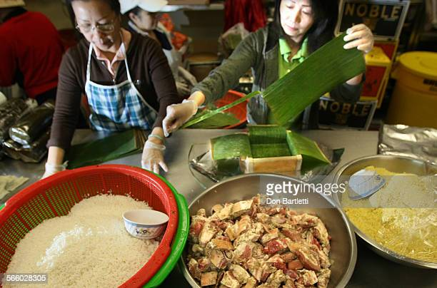 VALLEY CA In the kitchen of the Tan Hoang Huong Bakery women prepare traditional Vietnamese specialties for the coming Tet holiday Banh Chung is made...