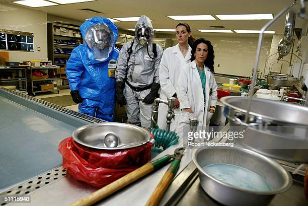 In the main autopsy room for the Office of the Chief Medical Examiner for New York two medical investigators in a Level A Hazmat suite Frank DePaolo...