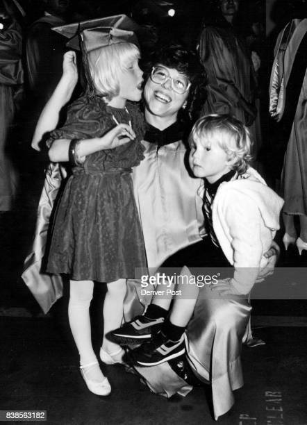 MAY 22 1988 in the middle is Donna Gray age 35 her daughter Megan age 5 is on the right giving her a kiss her son Spencer is on the right Donna is...