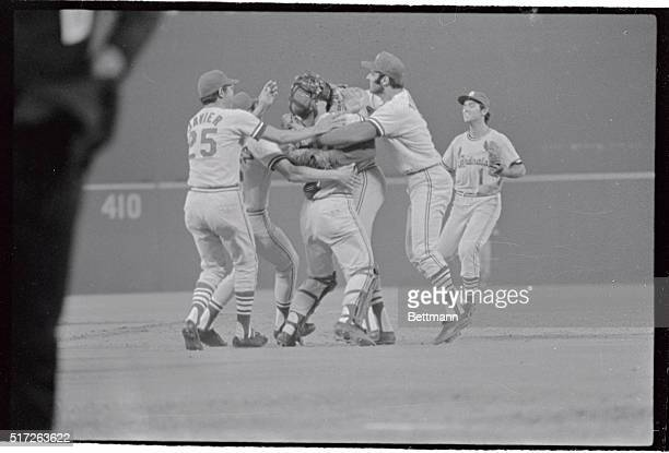 In the middle of the crowd is Cards pitcher Bob Gibson being congratulated by teammates Javier Cruz Torre and Kubiak after completing the first no...