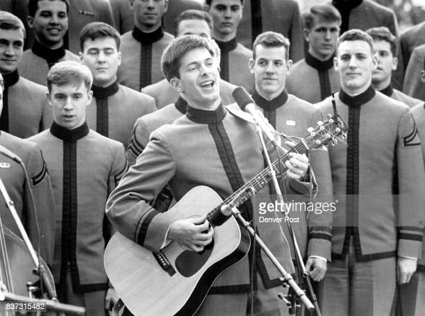 MAR 7 1987 in the middle with guitar is Kenn Griggs one of three members of the Headliners one of the West Points Cadet Glee Club specialty groups...