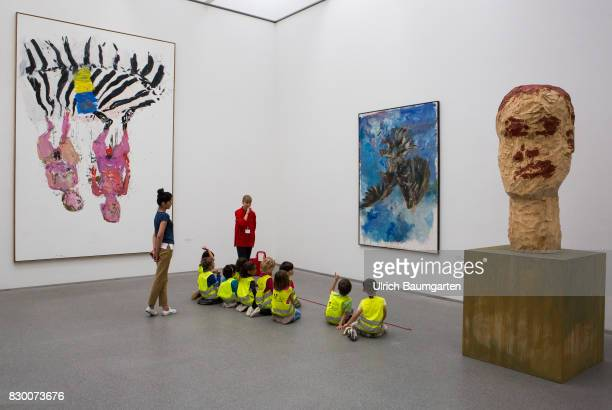 In the Museum Pinakothek der Moderne in Munich Adolescents and children in front of the works of Georg Baselitz Bedroom 2005 Finger painting and...