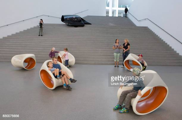 In the Museum Pinakothek der Moderne in Munich Luigi Colani and a part of its form study for a winglike solar vehicle Children