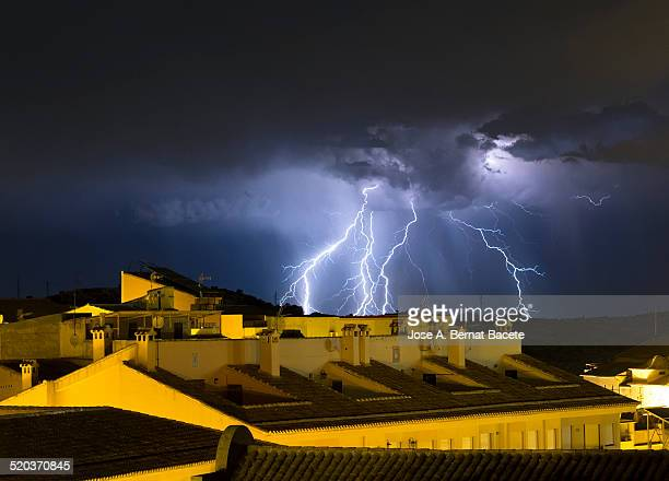 In the night of storm with beams on the houses