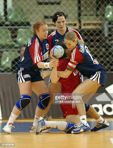 In the Norwegian ring Karoline Breivang Randi Gustad and Gro Hammerseng Russian Ludmyla Bodnieva fights for the ball during a mainround match of the...