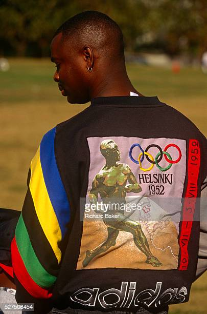In the runup to the forthcoming Olympics in Atlanta a young black man displays a vintage design for the '52 Helsinki games With the corporate sports...