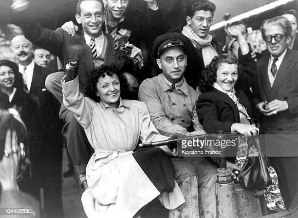 In the SaintLazare Station Paris the popular French singer Edith PIAF and the Compagnons de la Chanson are going thru a little luggage train to get...