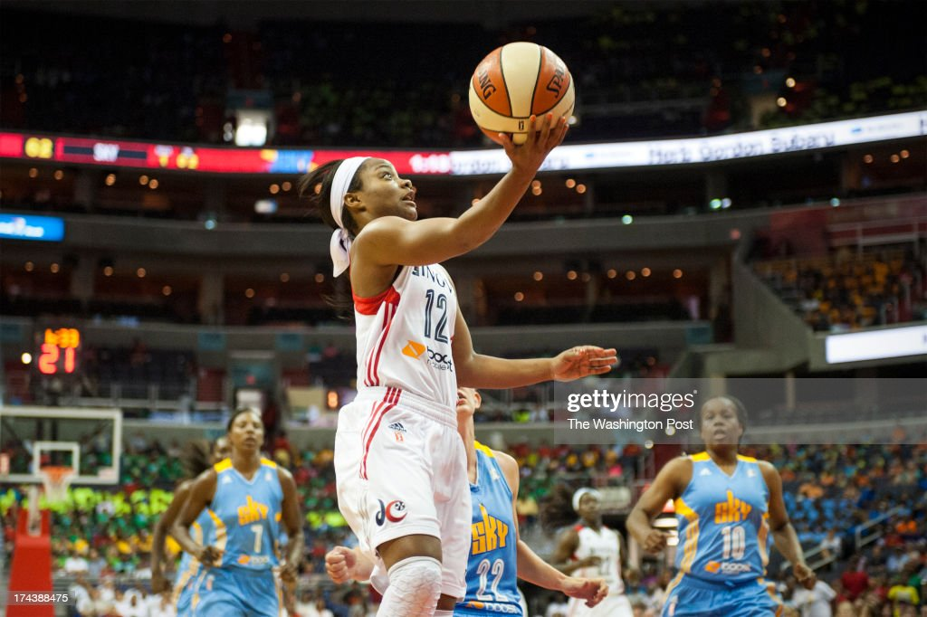 In the second half Washington Mystics guard Ivory Latta (12) goes up for the breakaway layup in the third period for two of her team high 18 points at Verizon Center Wednesday July 24, 2013 in Washington, DC. The Washington Mystics beat the Chicago Sky 82-78.
