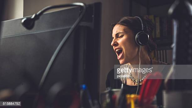 In the small business office: woman singing at work