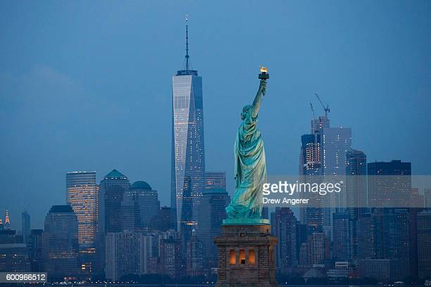 in The Statue of Liberty stands in the foreground as Lower Manhattan is viewed at dusk September 8 2016 in New York City New York City is preparing...