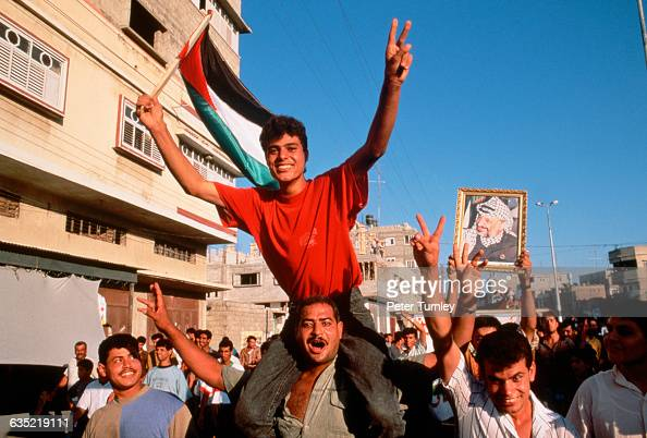 In the streets of Gaza tens of thousands of Palestinians celebrated the signing of the PalestinianIsraeli Peace Accords